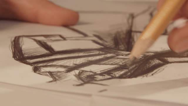 Hands draw with a pencil. Fashion designer drawing in a studio. Close up video