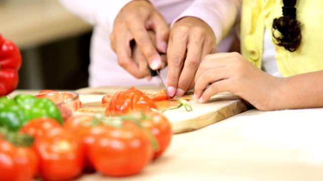 Hands Ethnic Mother Young Daughter Kitchen Slicing Vegetables video