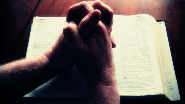 Hands Folding On Bible video