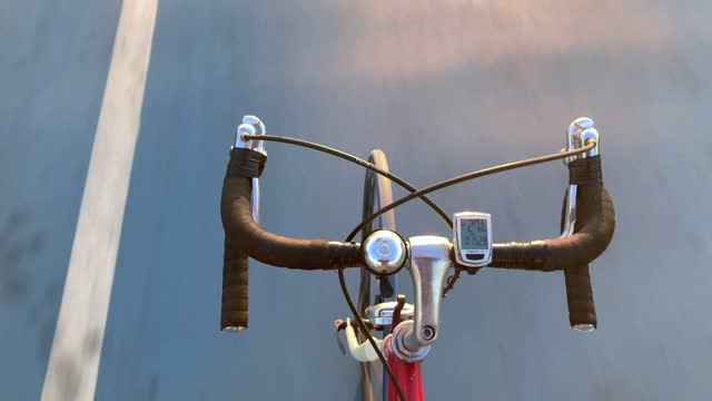 Hands free cycling at bicycle lane directly above view of steel vintage cromoly road bicycle handlebar stock videos & royalty-free footage