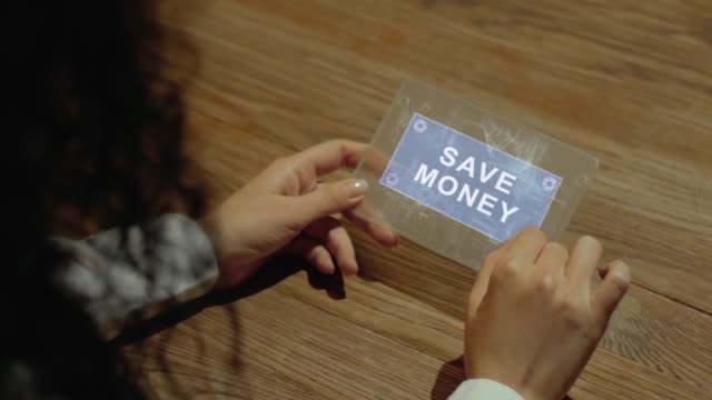 Hands hold tablet with text Save money