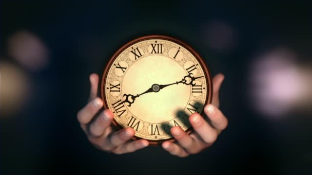 Hands holding a clock. video