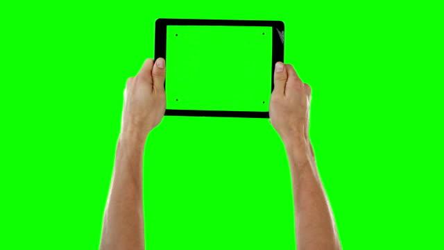 Hands holding digital tablet video