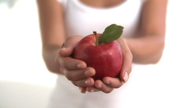 Hands holding red apple video