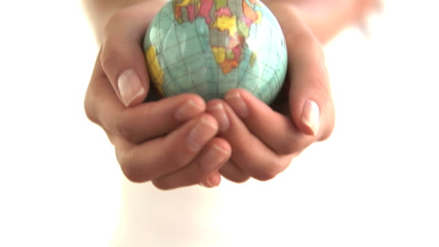 Hands holding small globe video