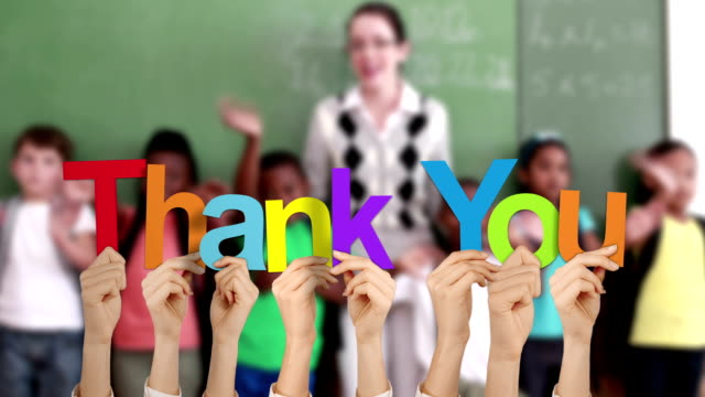 Hands holding up thank you Hands holding up thank you against school setting thank you stock videos & royalty-free footage