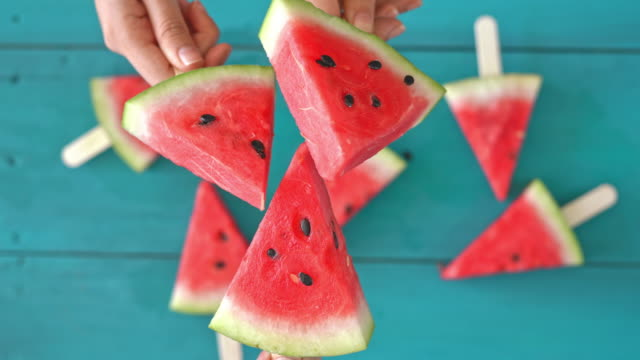 Hands holding watermelon slices high angle view Hands holding watermelon slices high angle view watermelon stock videos & royalty-free footage