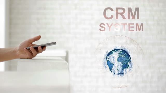 Hands launch the Earth's hologram and CRM system text