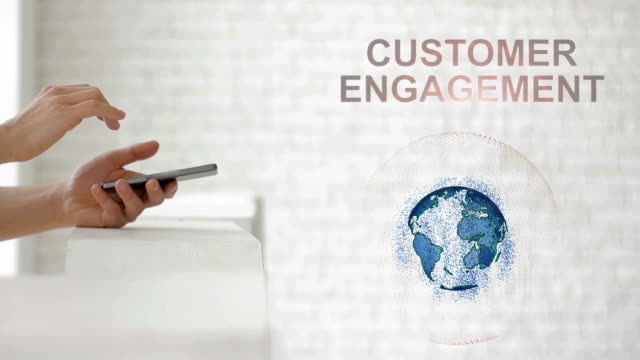 Hands launch the Earth's hologram and Customer engagement text video