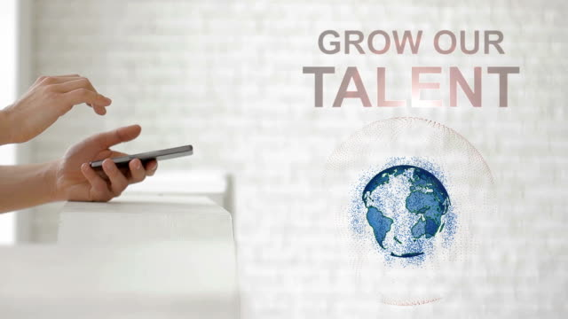 Hands launch the Earth's hologram and Grow our talent text