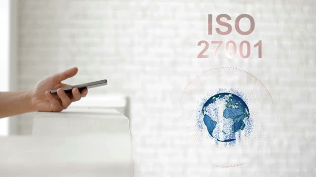 Hands launch the Earth's hologram and ISO 27001 text