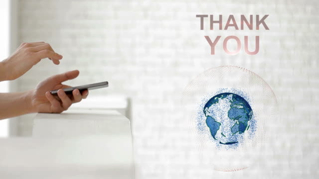 Hands launch the Earth's hologram and Thank you text video