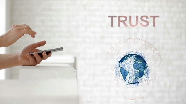 Hands launch the Earth's hologram and Trust text video