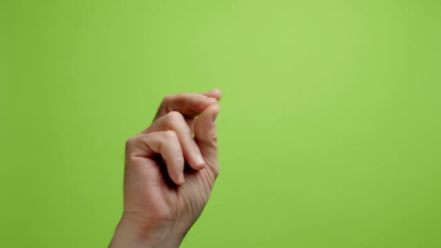 Hands make symbol. Hand with snapping fingers on green background Hands make symbol. Hand with snapping fingers on green background. snapping stock videos & royalty-free footage