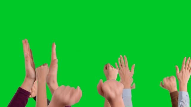 vídeos de stock e filmes b-roll de hands making cheering gestures on chroma key - braços no ar