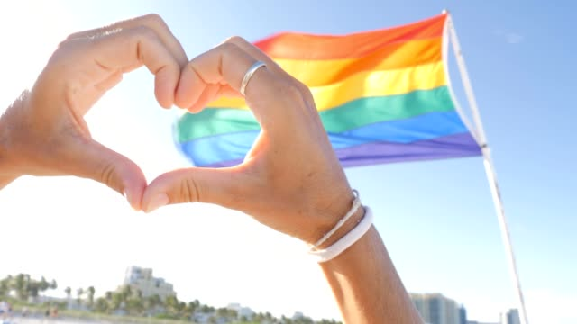 Hands making heart with hands on gay rainbow flag, Miami Beach, Lgbt concept, Miami Beach -slow motion Hands making heart with hands on gay rainbow flag, Miami Beach, Lgbt concept, Miami Beach -slow motion pride stock videos & royalty-free footage