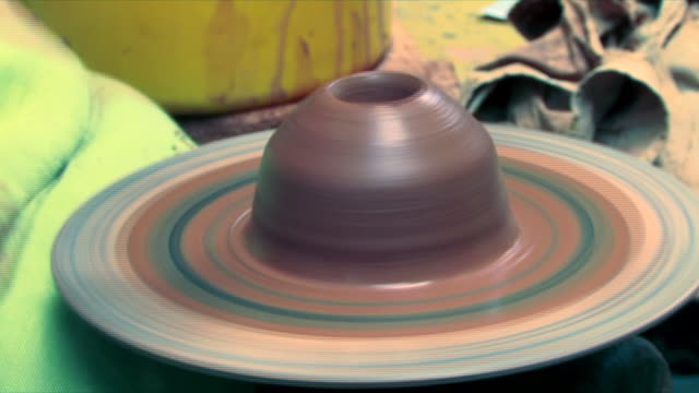 Hands making pottery on a Wheel video