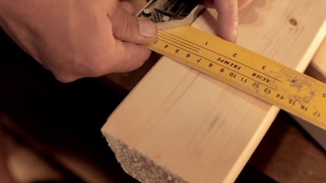 Hands Measuring Wooden Plank video