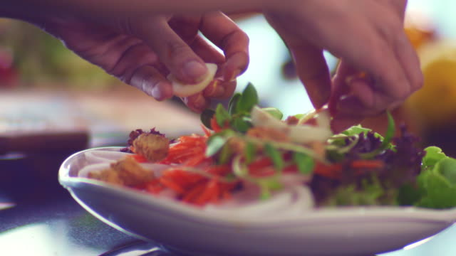 Hands mixing vegetables in salad bowl. Ready-To-Eat , Homemade Food lettuce stock videos & royalty-free footage