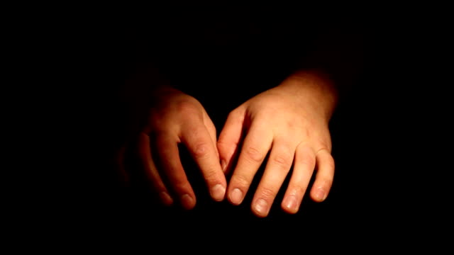 Hands nervously as if waiting for something Hands nervously as if waiting for something. Isolated on a black background impatient stock videos & royalty-free footage
