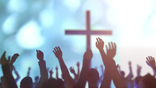 hands of a crowd of people at a Christian meeting during the glorification praise of God against the background of the cross 3d render