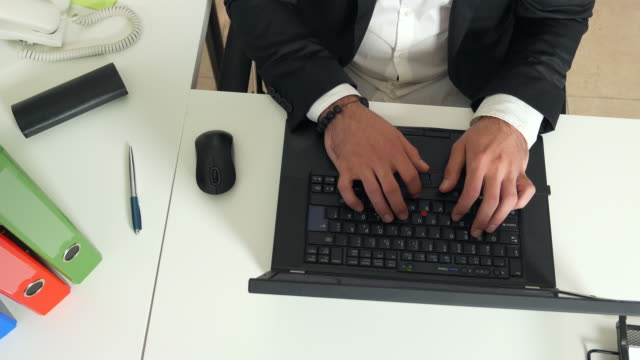 Hands of a man office worker typing on a keyboard video
