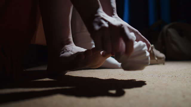 Hands of a person is sitting on the sofa taking off the socks video