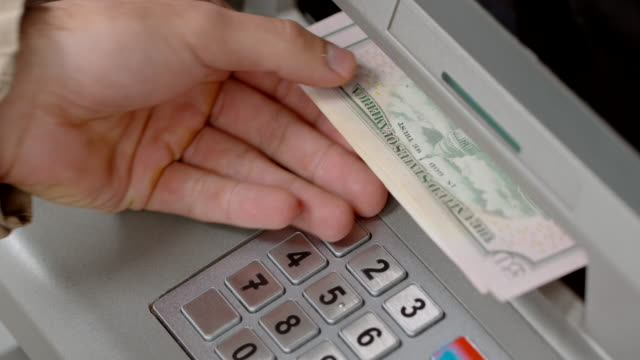 hands of a person making a cash withdrawal at an atm - banks and atms stock videos & royalty-free footage