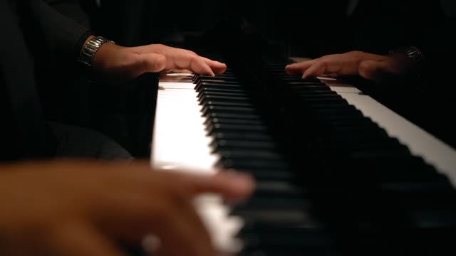 hands of a pianist playing piano at a party