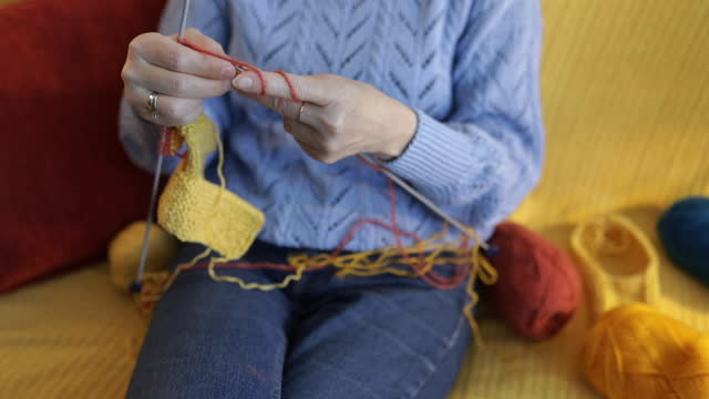 Hands of a senior woman knitting.
