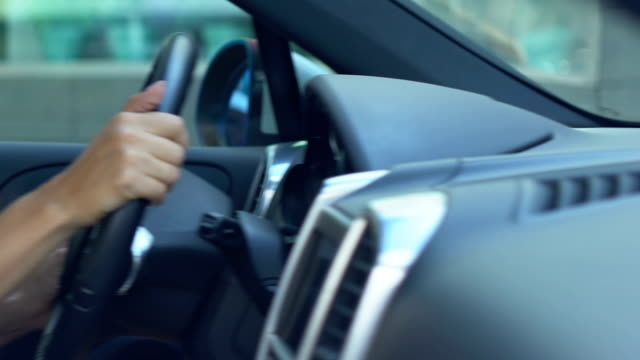 Hands of business lady turning steering wheel woman riding car during test drive Hands of business lady turning steering wheel woman riding car during test drive car rental stock videos & royalty-free footage