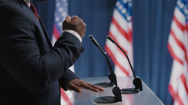 Hands Of Candidate For Presidency Side view shot footage of unrecognizable African American man taking part in election debates using hand gestures when speaking president stock videos & royalty-free footage