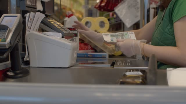 hands of cashier and customer - essential workers stock videos & royalty-free footage
