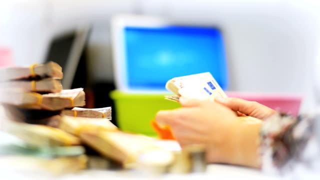 Hands of cashier video