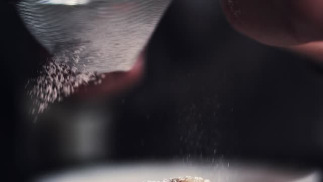 hands of cook adding powdered sugar on the peice pie - panettone video stock e b–roll