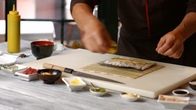 Hands of cook make sushi video