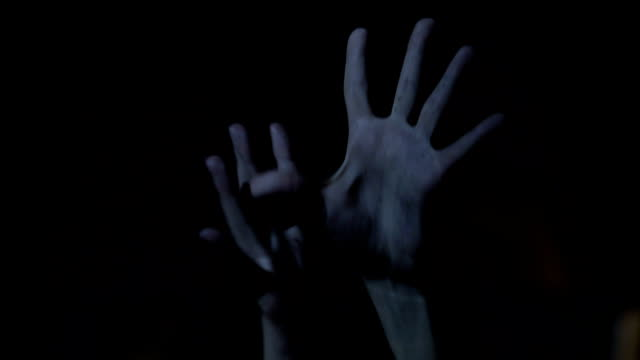 Hands of drug addict person stretching out, convulsing, psychopath in darkness video