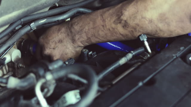 Hands of engineering and auto mechanic repairing car video