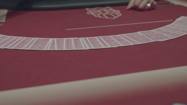 Hands of female dealer of casino shuffle and perform trick with poker cards video
