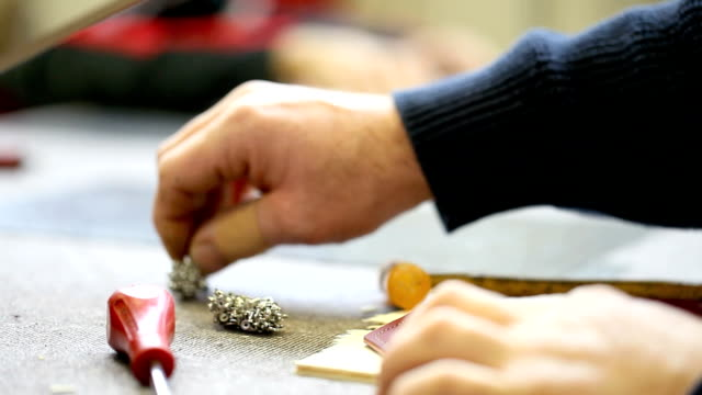 hands of handicraftsman work the leather video
