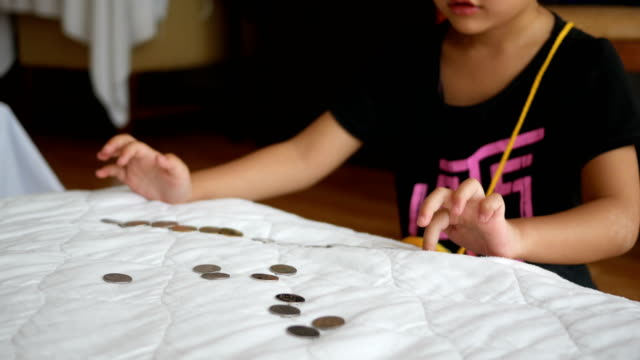 Hands of little girl counting coins video