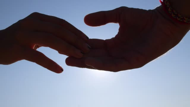 Hands of Man and Woman Parting Against Sky With Sun. Break Up. Hands of Man and Woman Parting Against Sky With Sun. Break Up. Close-Up. HD, 1920x1080. relationship breakup stock videos & royalty-free footage