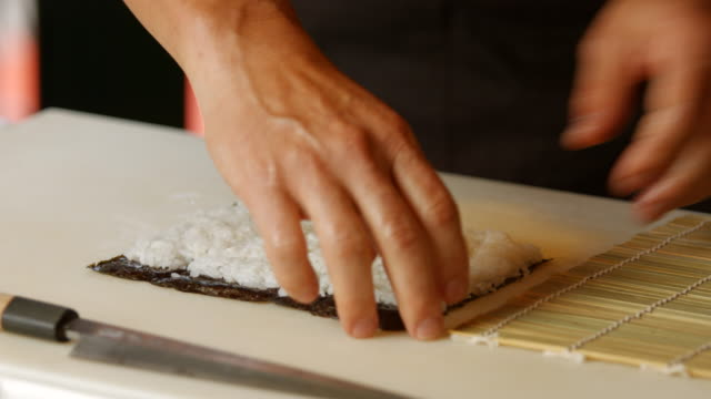 Hands of man preparing sushi. video