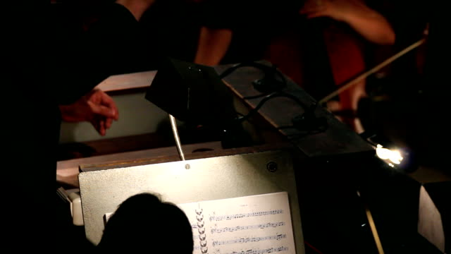 hands of man who conducts orchestra - timelapse hands of man who conducts orchestra - timelapse musical theater stock videos & royalty-free footage