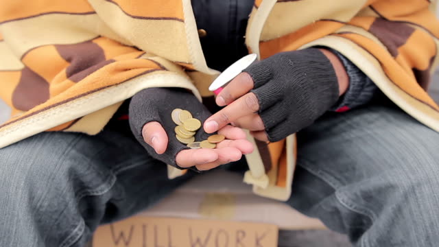 Hands of miserable beggar counting charity money given by kindhearted people video