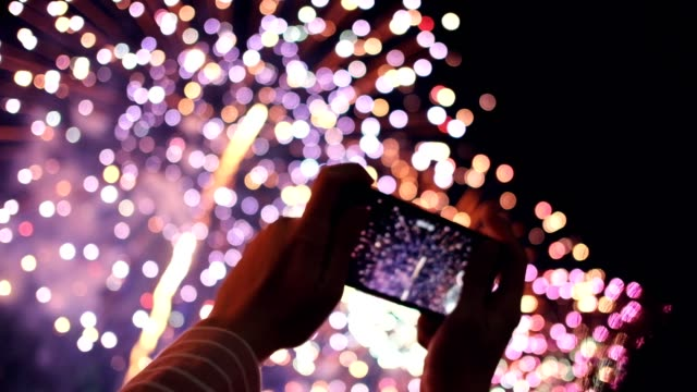 Hands of peoples taking photo to fireworks on smartphone. Hands of peoples taking photo to fireworks on smartphone. bastille day stock videos & royalty-free footage