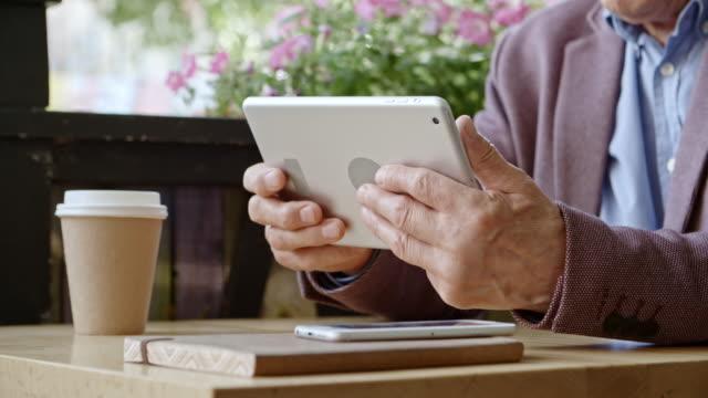 Hands of Senior Man Using Digital Tablet video