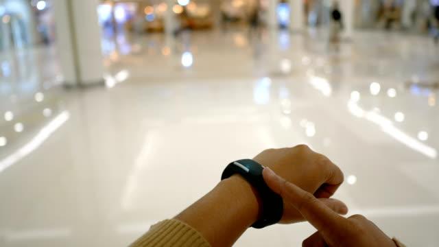hands of woman using smart watch with hud ui user interface for cyber futuristic concept - носимый компьютер стоковые видео и кадры b-roll