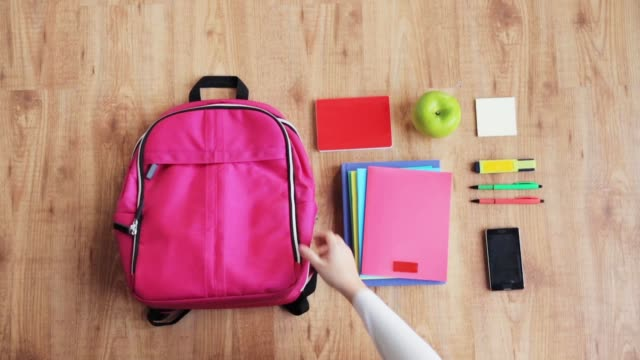 hands packing schoolbag - school supplies stock videos and b-roll footage