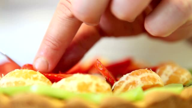 hands pastry chef preparing a fruit tart video